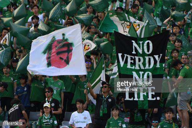 Supporters of Tokyo Verdy cheer prior to the J.League J2 match between Tokyo Verdy and JEF United Chiba at Ajinomoto Stadium on May 25, 2019 in...