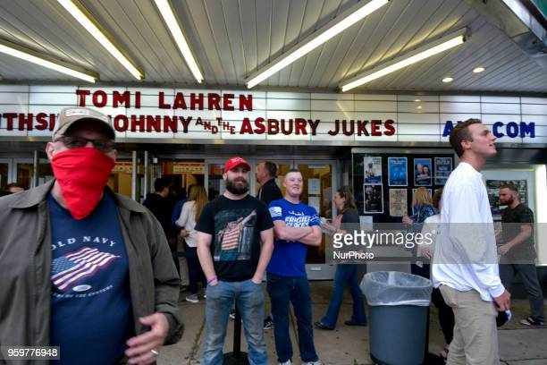 Supporters of Tomi Lahren face off with a group of protestors across the street ahead of a tour stop by conservative political commentator and Fox...