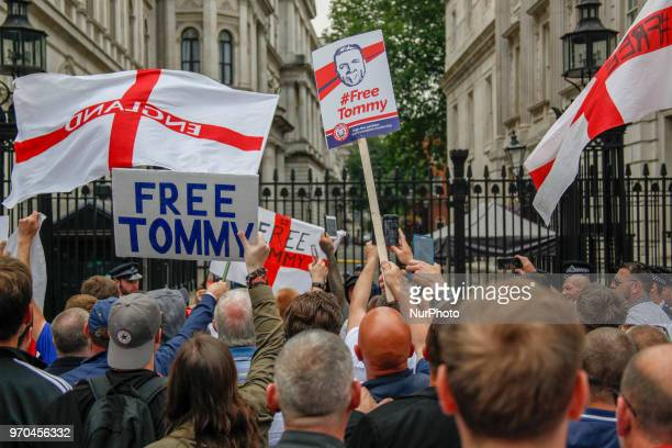Supporters of Tommy Robinson rush the gates at Downing Street during a 'Free Tommy Robinson' protest on Whitehall on June 9 2018 in London England...