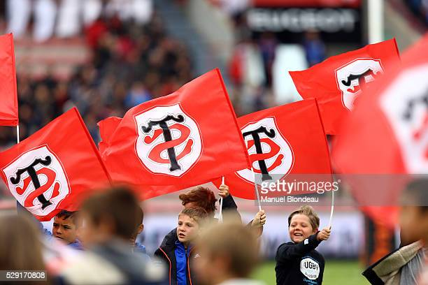 Supporters of Toulouse wave flags during the French Top 14 rugby union match between Toulouse v Agen at Stade Ernest Wallon on May 8 2016 in Toulouse...