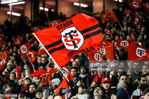 Supporters of Toulouse wave flags during the Top 14 match between Toulouse and Toulon at Stade Ernest Wallon on December 29, 2019 in Toulouse, France.