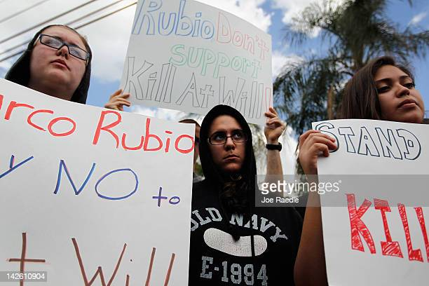 Supporters of Trayvon Martin gather for a rally in front of Florida Senator Marco Rubio's office to ask him to retract his support for Florida's so...