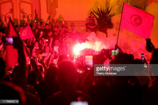 Supporters of Tunisian presidential candidate Kais Saied celebrate in the street after the first exit poll in presidential runoff vote suggest he is...