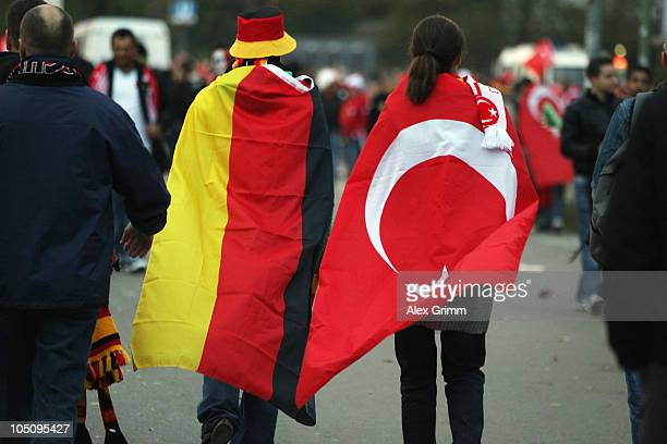 Supporters of Turkey and Germany arrive for the EURO 2012 group A qualifier match between Germany and Turkey at the Olympic Stadium on October 8 2010...