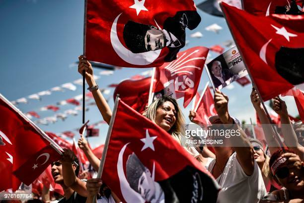 TOPSHOT Supporters of Turkey's main opposition party presidential candidate Muharrem Ince cheer during a preelection speach in Istanbul on June 16...