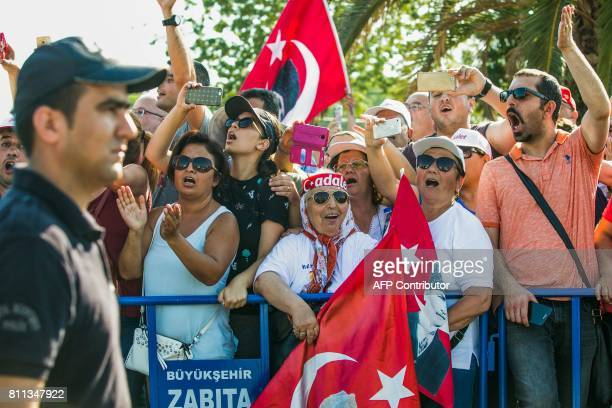 Supporters of Turkey's main opposition Republican People's Party chants slogans during a rally in the Maltepe district of Istanbul on July 9 marking...