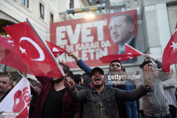Supporters of Turkey's president gather near the headquarters of the conservative Justice and Development Party on April 16 2017 in Istanbul after...
