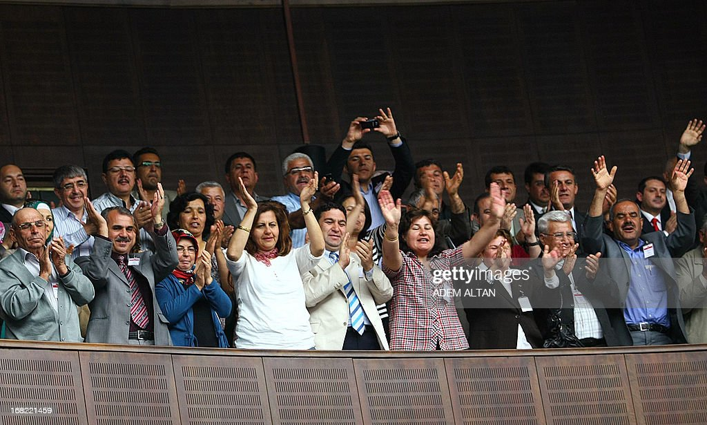 Supporters of Turkey's Prime Minister Recep Tayyip Erdogan shout slogans as he arrives to address members of parliament from his ruling AK Party (AKP) during a meeting at the Turkish parliament in Ankara on May 7, 2013. Erdogan said on May 7 that Israel's air raids on military sites in Syria were 'unacceptable.' 'No excuse can justify this operation,' Erdogan told ruling party lawmakers in parliament after Israel's weekend strikes on the war-torn country sent regional tensions soaring.