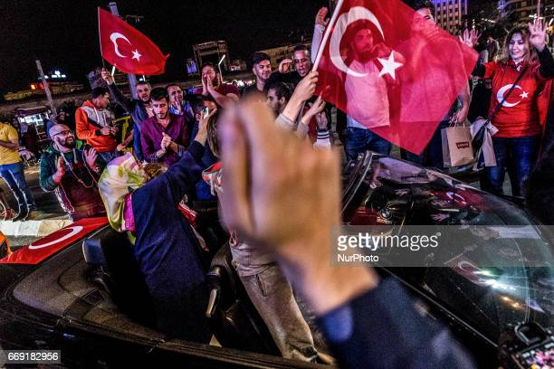 Supporters of Turkish president celebrate during a rally near the headquarters of the conservative Justice and Development Party on April 16 2017 in...