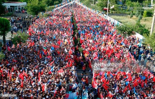 Supporters of Turkish President Recep Tayyip Erdogan attends Turkey's ruling Justice and Development Party's rally in Diyarbakir on June 3 2018...