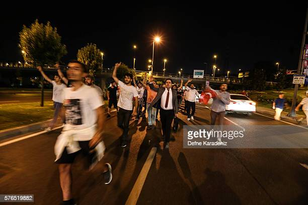 Supporters of Turkish President Recep Tayyip Erdogan chant slogans in the early morning hours of July 16, 2016 in Istanbul, Turkey. Istanbul's...