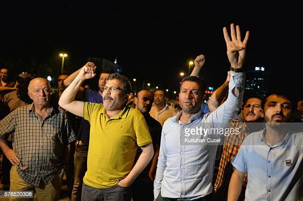 Supporters of Turkish President Recep Tayyip Erdogan chant slogans on the main streets on July 15, 2016 in Ankara, Turkey. Istanbul's bridges across...