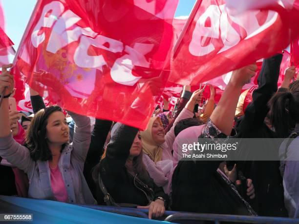 Supporters of Turkish President Recep Tayyip Erdogan cheer during 'Izmir Gathering' ahead of the constitutional referendum on April 9 2017 in Izmir...