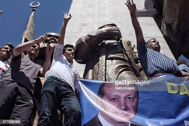 Supporters of Turkish President Recep Tayyip Erdogan hold up a banner during a rally in Fatih district on July 19 2016 in Istanbul Turkey Clean up...