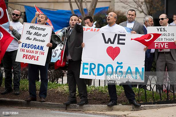 Supporters of Turkish President Recep Tayyip Erdogan rally and shout at antiErdogan protestors outside of the Brookings Institution March 31 2016 in...