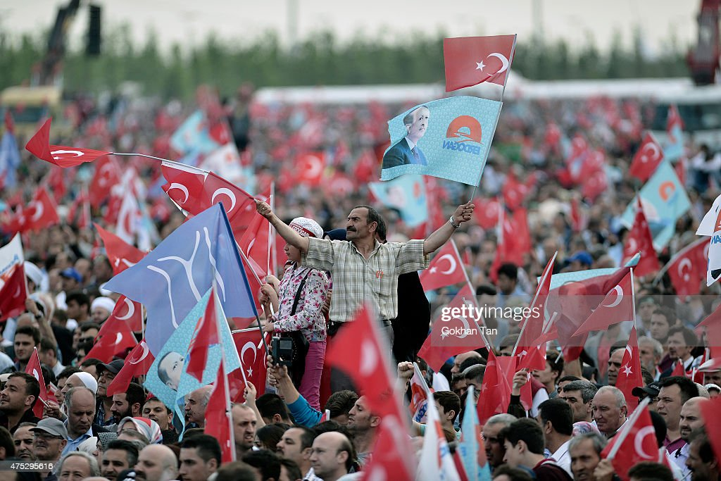 Supporters of Turkish President Tayyip Erdogan and Prime Minister and leader of the ruling Justice and Development Party (AKP) Ahmet Davutoglu wave national flags during a ceremony to mark the 562nd anniversary of the conquest of the city by Ottoman Turks on May 30, 2015 in Istanbul, Turkey. Erdogan has reportedly been criticized by the opposition parties for campaigning in favor of the ruling Justice and Development Party (AKP), a party he co-founded, even though as head of state the constitution bars him from party politics. Turkey will hold a general election on June 7, 2015 to elect the 550 members of the Grand National Assembly.