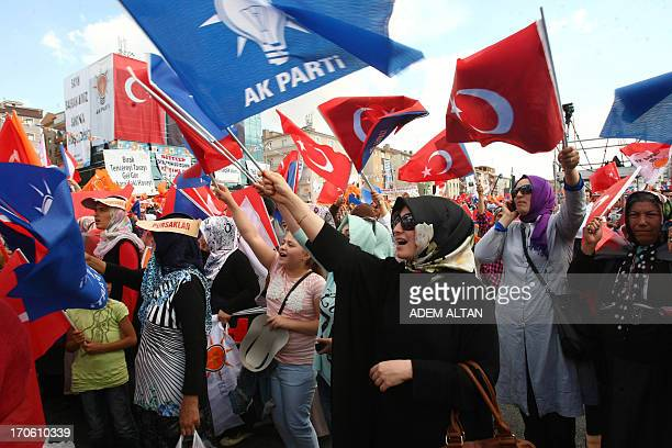 Supporters of Turkish Prime Minister Recep Tayyip Erdogan wave AKP party flags as they listen to him speak during a rally in Sincan on June 15 2013...