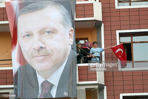 Supporters of Turkish Prime Minister Recep Tayyip Erdogan wave flags in Ankara on June 9 2013 in Ankara Erdogan on June 9 told supporters his...