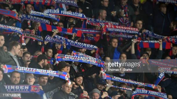 Supporters of Uerdingen cheer their team during the 3 Liga match between KFC Uerdingen 05 and SC Preussen Muenster at SchauinslandReisenArena on...