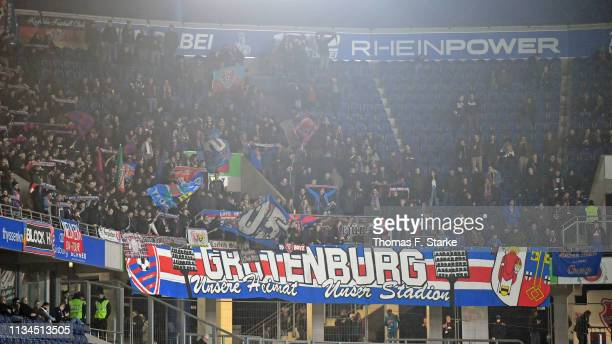 Supporters of Uerdingen cheer their team during the 3 Liga match between KFC Uerdingen 05 and Karlsruher SC at GrotenburgStadion on March 08 2019 in...