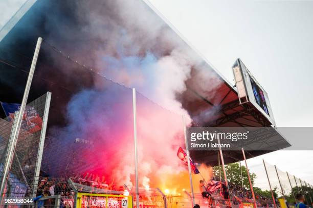 Supporters of Uerdingen light fireworks during the Third League Playoff Leg 2 match between SV Waldhof Mannheim and KFC Uerdingen at CarlBenzStadium...