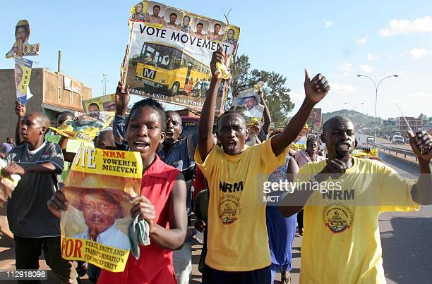 Supporters of Ugandan President Yoweri Museveni celebrate his successful bid for reelection in Uganda's first multparty elections in two decades in...