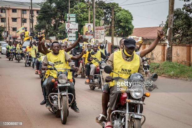 Supporters of Uganda's ruling National Resistance Movement party drive around Kampala on boda bodas following the announcement that Yoweri Museveni...