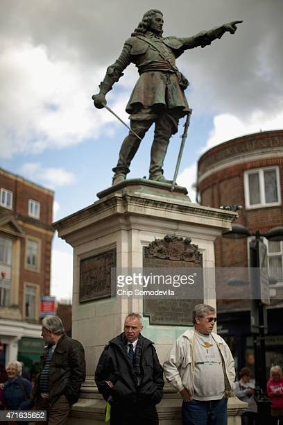 Supporters of UK Independence Party leader Nigel Farage gather at the base of the statue of John Hampden before Farage's arrival in Market Square on...