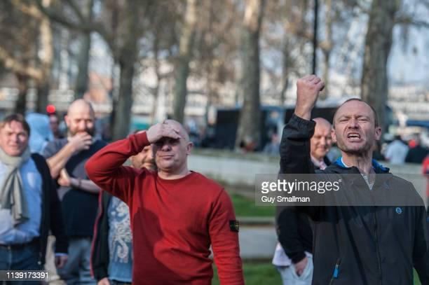 Supporters of UKIP and Tommy Robinson attempt to harass rival anti racist protestors at Parliament Square on March 29, 2019 in London, England. Today...