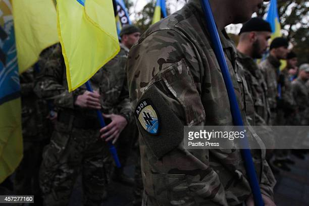 Supporters of Ukrainian Nationalist Party hold torches and flags, as they march in Kiev downtown during the 72nd anniversary of the Ukrainian...