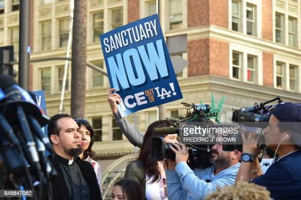 Supporters of undocumented Romulo AveliaGonzalez who was arrested by ICE agents last week attend a rally in downtown Los Angeles California on March...