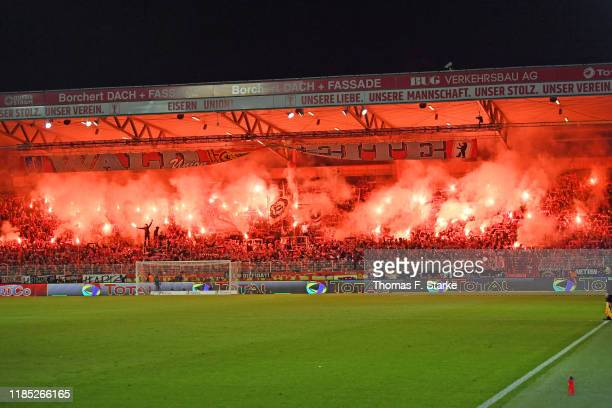 Supporters of Union light flares during the Bundesliga match between 1. FC Union Berlin and Hertha BSC at Stadion An der Alten Foersterei on November...