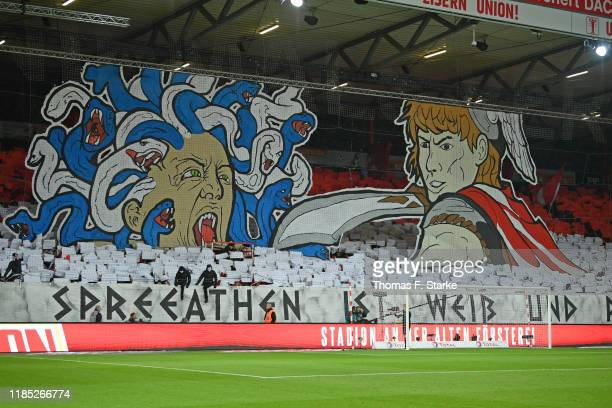 Supporters of Union show a choreography during the Bundesliga match between 1. FC Union Berlin and Hertha BSC at Stadion An der Alten Foersterei on...