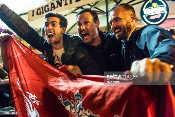 Supporters of United Kingdoms Liverpool team sing stadium chants in a pub in Campo de' Fiori Square in Rome Italy the night before UEFA Champions...