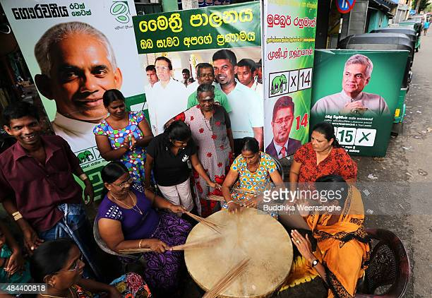 Supporters of United National Party perform traditional drum as celebrate their party victory on August 18 2015 in Colombo Sri Lanka Sri Lanka's...