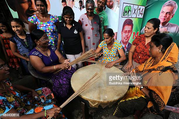 Supporters of United National Party perform with a traditional drum as they celebrate their party victory on August 18 2015 in Colombo Sri Lanka Sri...