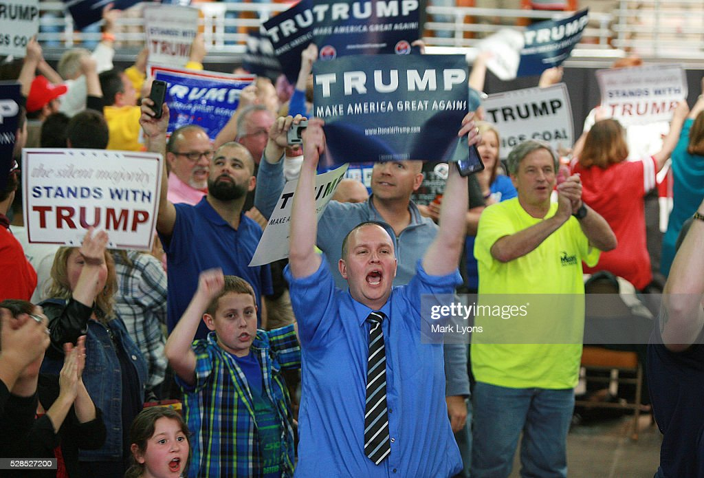 Supporters of United States Republican Presidential candidate Donald Trump scream at the media prior to the rally at the Charleston Civic Center on May 5, 2016 in Charleston, West Virginia. Trump became the Republican presumptive nominee following his landslide win in indiana on Tuesday.