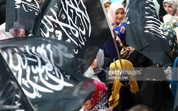 Supporters of unseated Egypt's Islamist president Mohamed Morsi demonstrate outside the Kocatepe Mosque in Ankara on August16 2013 Around 3000...
