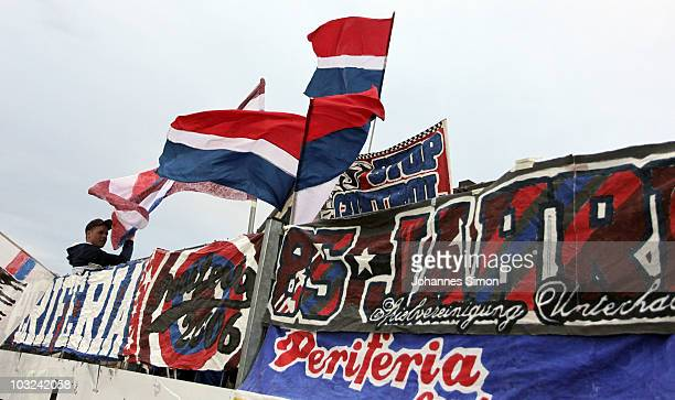 Supporters of Unterhaching wave flags during the 3Liga match between SpVgg Unterhaching and Rot Weiss Ahlen at the Generali Sportpark on August 3...