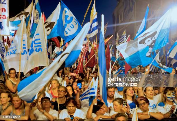 Supporters of Uruguay's presidential candidate for the opposition Partido Nacional party Luis Lacalle Pou attend the closing rally of his campaign...