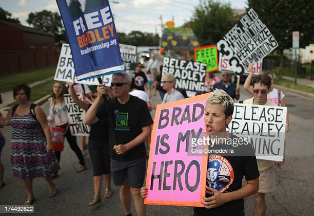 Supporters of US Army Private First Class Bradley Manning protest his detention by marching around the perimeter and blocking the gates of Fort...