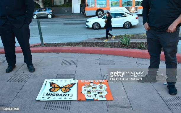 Supporters of US born daughters of undocumented Romulo AveliaGonzalez who was arrested by ICE agents last week attend a rally in downtown Los Angeles...