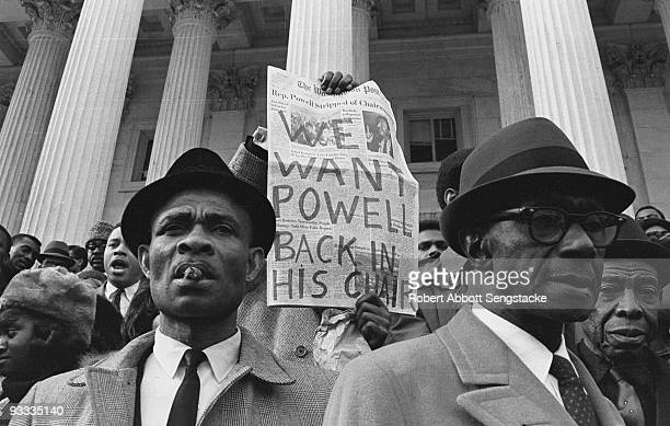Supporters of US Congressman Adam Clayton Powell Jr rally to protest his having been stripped of the chairmanship of the Education and Labor...