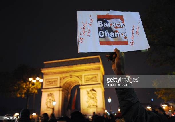 Supporters of US Democratic party elected president Barak Obama celebrate on November 5 2008 in the ChampsElysees in Paris during a rally called by...