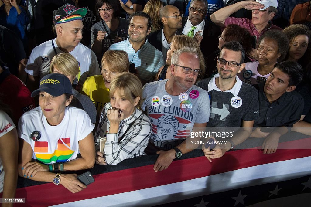 Supporters of US Democratic presidential candidate Hillary Clinton listen to President Barack Obama speak at a campaign event for Clinton in Las Vegas on October 23, 2016. / AFP / NICHOLAS