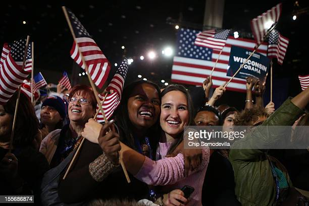 Supporters of US President Barack Obama cheer after networks project Obama as reelected during the Obama Election Night watch party at McCormick...