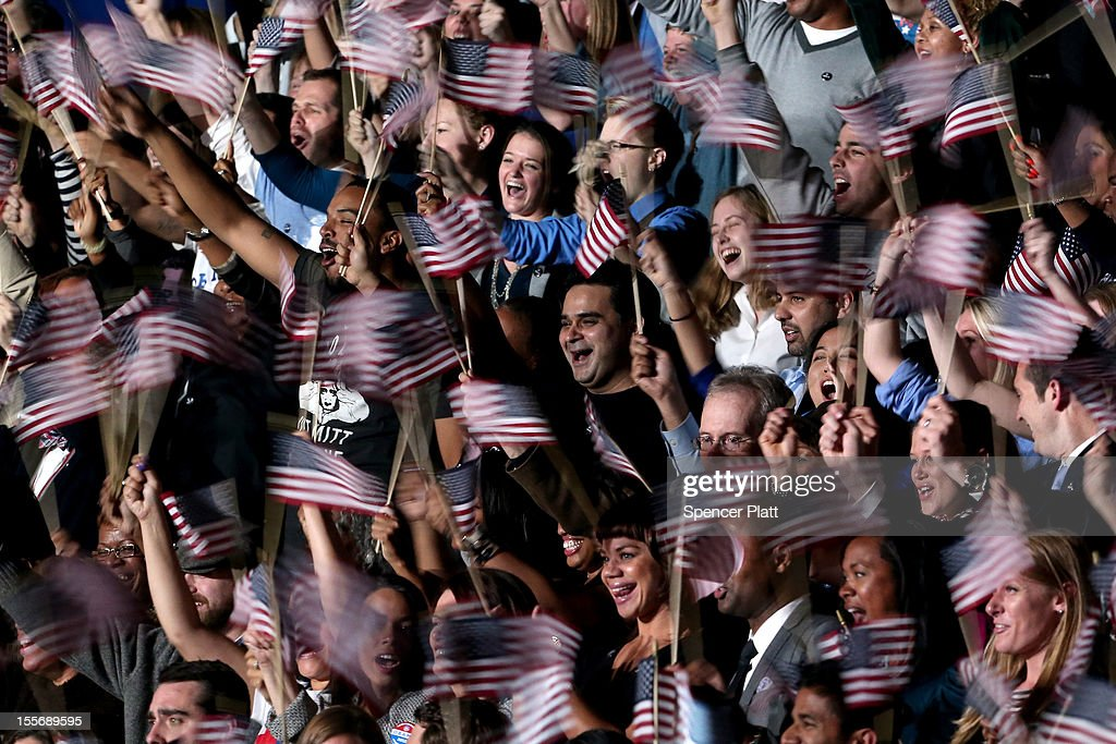 Supporters of U.S. President Barack Obama cheer as they wait for Obama to appear on stage for his victory speech at McCormick Place November 6, 2012 in Chicago, Illinois. Obama won reelection against Republican candidate, former Massachusetts Governor Mitt Romney.