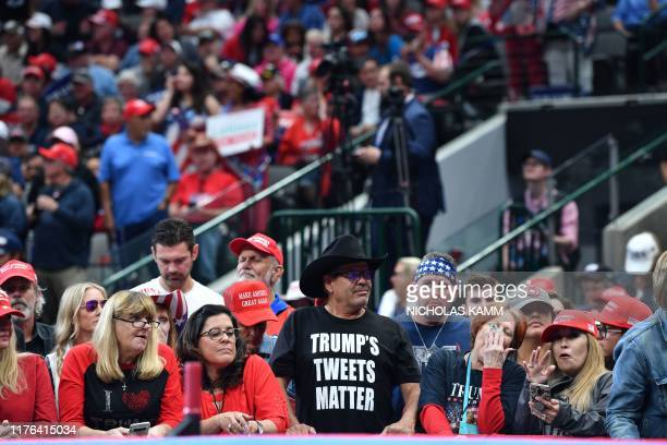 """Supporters of US President Donald Trump attend a """"Keep America Great"""" rally at the American Airlines Center in Dallas, Texas on October 17, 2019."""