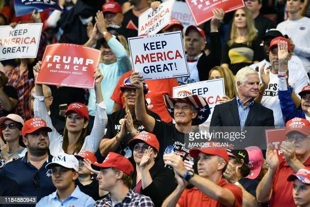 """Supporters of US President Donald Trump attend a """"Keep America Great"""" campaign rally at the BB&T Center in Sunrise, Florida on November 26, 2019."""