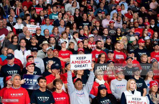 """Supporters of US President Donald Trump attend a """"Keep America Great"""" campaign rally at Huntington Center in Toledo, Ohio, on January 9, 2020."""